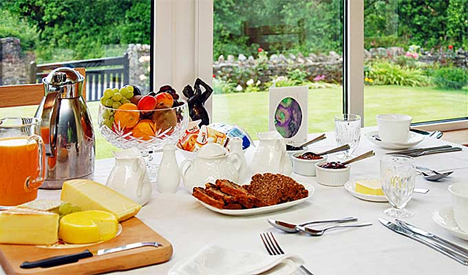 Choose from our Breakfast Menu and look out at the garden