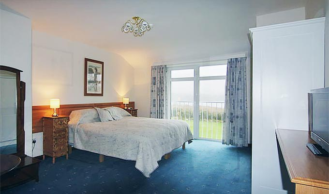One of our comfortable rooms with a view of the bay