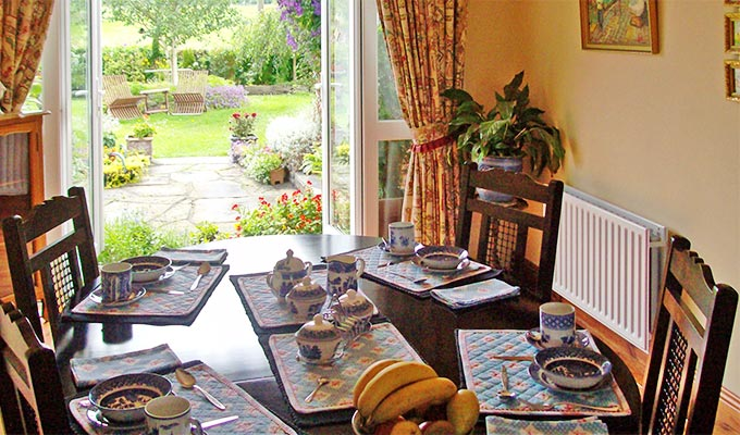 The breakfast room looking out towards the gardens.