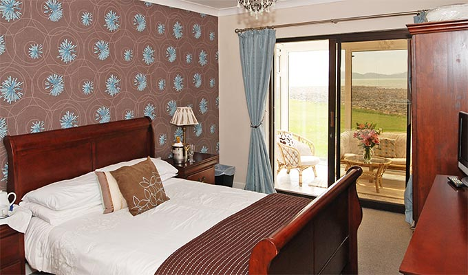 A king size bed and an enclosed balcony facing Ballinskelligs Bay. Just perfect.