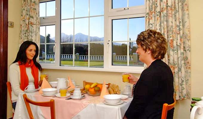 Enjoy breakfast views to the magnificent Killarney Mountains